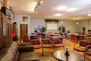 Party Room Rental with couches, tables, and chairs
